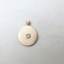 gold medallion pendant